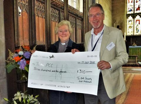 Rev'd Pippa Thorneycroft received a cheque from Chairman Rob Hubbleday